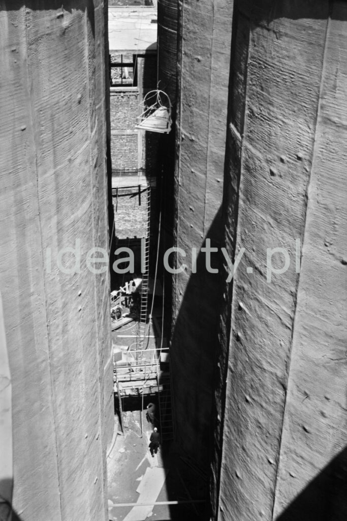 A shot from height on huge, vertical tanks located next to each other.