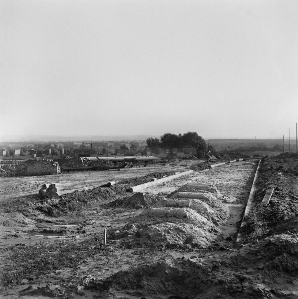 Road construction, on the sides of the field.