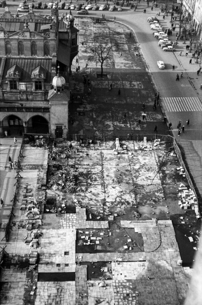 The top view of the square in the old part of the city, where the asphalt has been torn off, you can see slabs and paving stones being laid