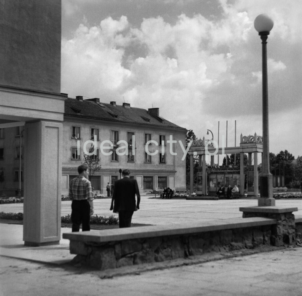 A view of the city square with a columned structure in the middle with a display case.