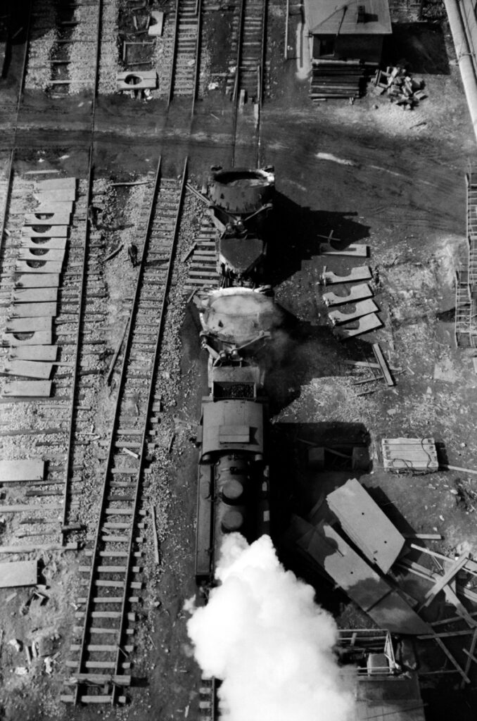 Top view of the transport locomotive, industrial chaos all around.
