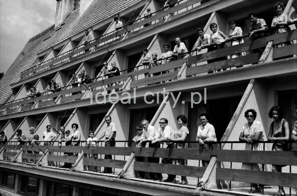 Holidaymakers on the balconies of the holiday home.