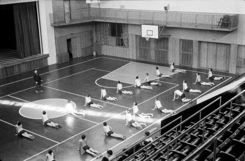 Young people during exercises in a sports hall.