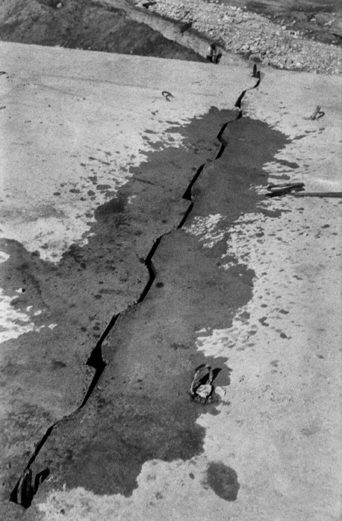 The shot shows a water-moistened connection of prefabricated concrete slabs.