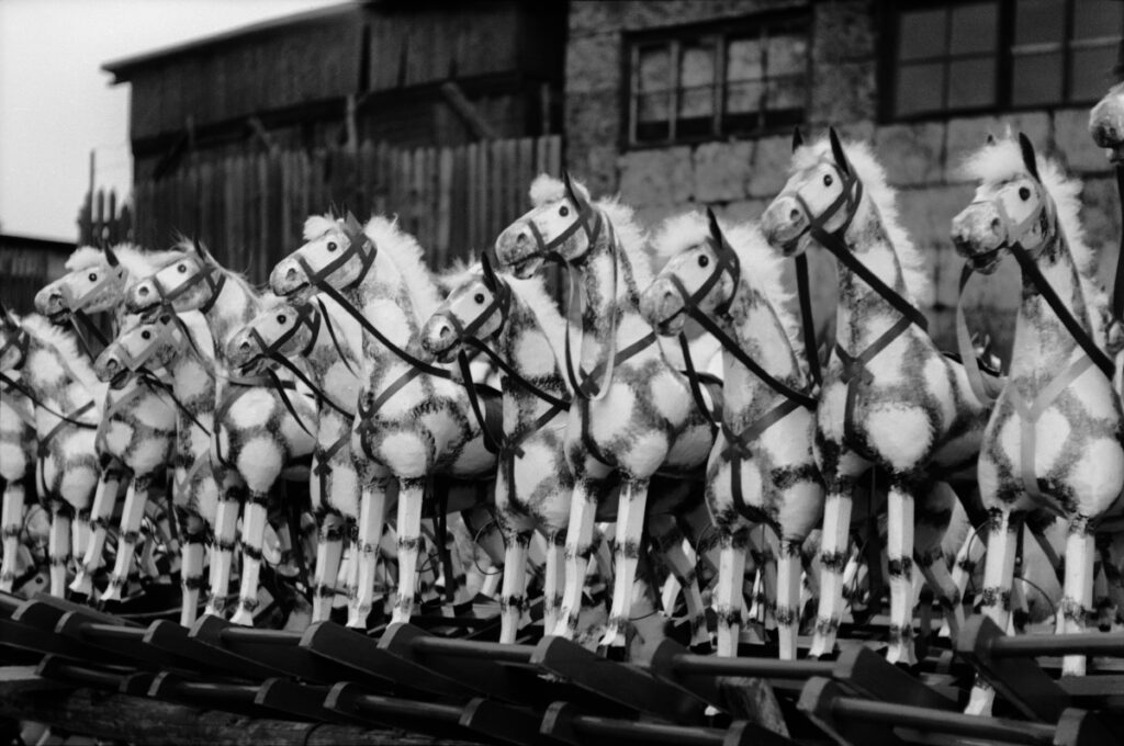 Serie of rocking horses exposed for sale.