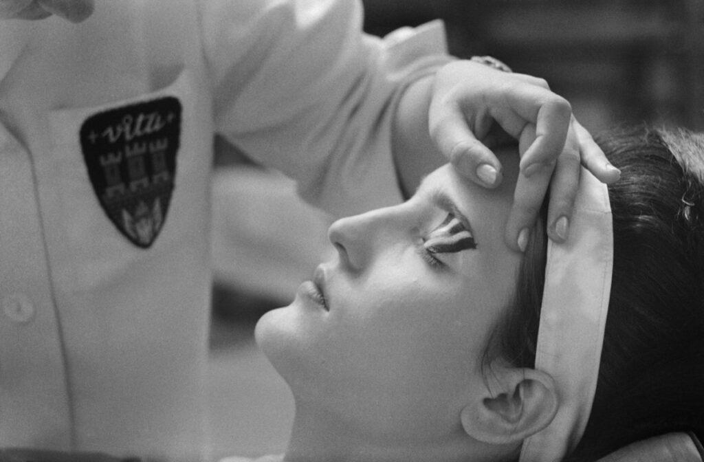 Portrait of a woman preparing op art make-up