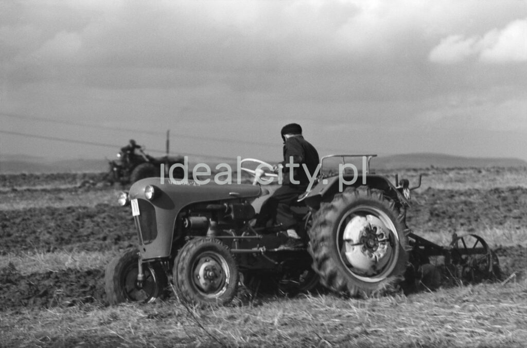 A man is plowing a field with a tractor.