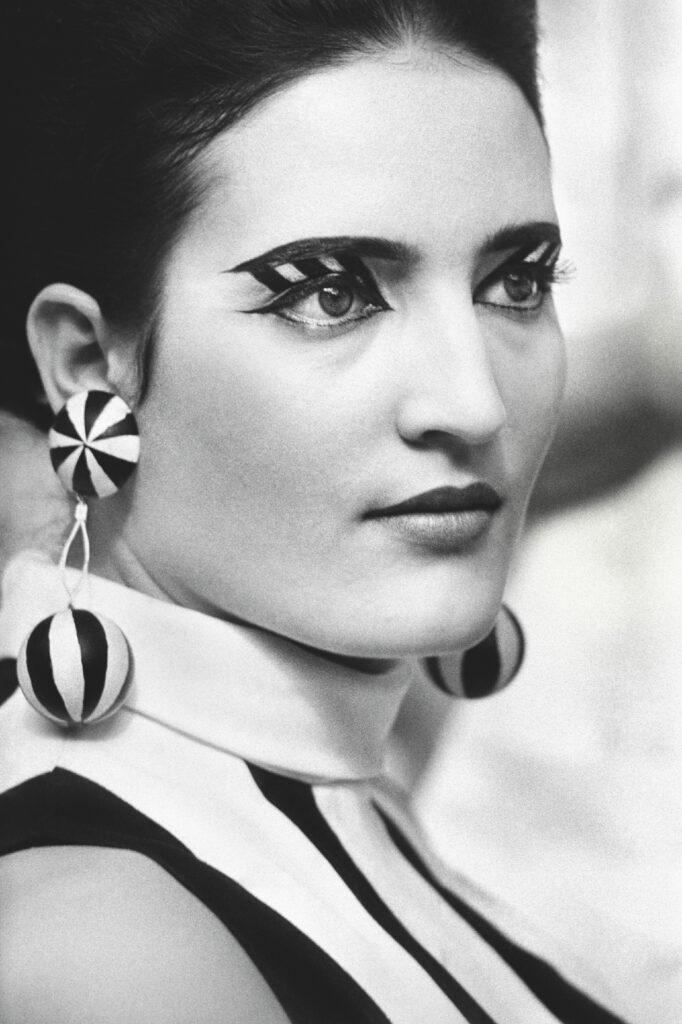 Portrait of a woman in op art makeup.