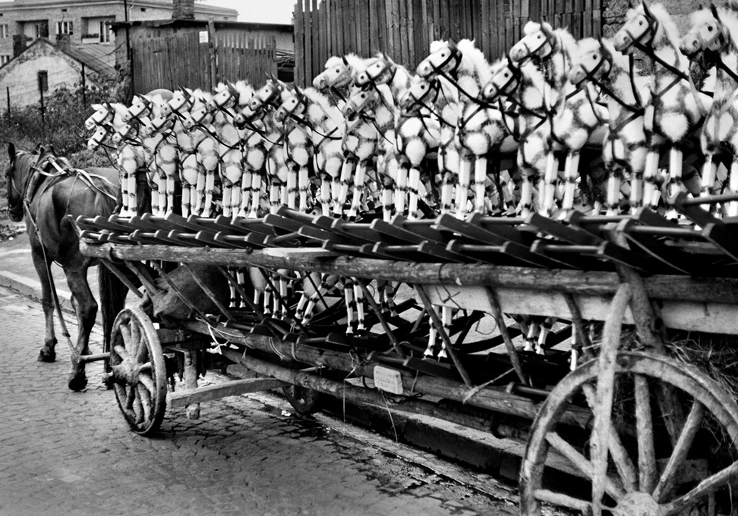 rocking horses on a wooden horse cart