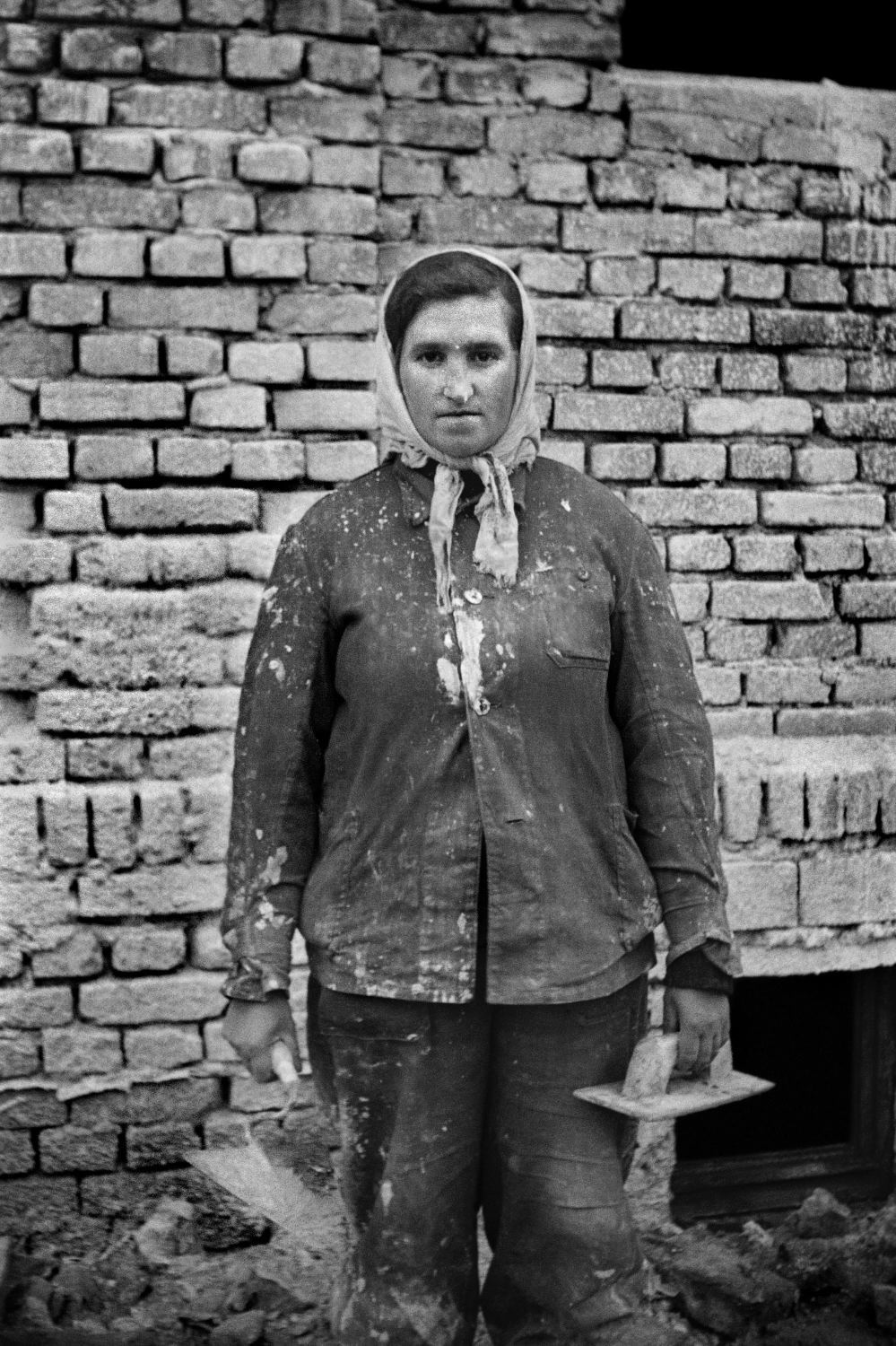 Female worker standing in front of the camera
